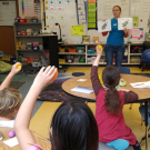 Dr. Deborah Thomson explaining One Health to elementary students in a classroom.